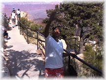 Diann waves to the camera at the Grand Canyon