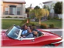 Diann get a ride in the Jaguar